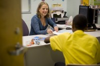 Alachua County nutritionist with the federal program WIC, Hannah Stahmer, consults with a client. Photo by Priscilla Santos
