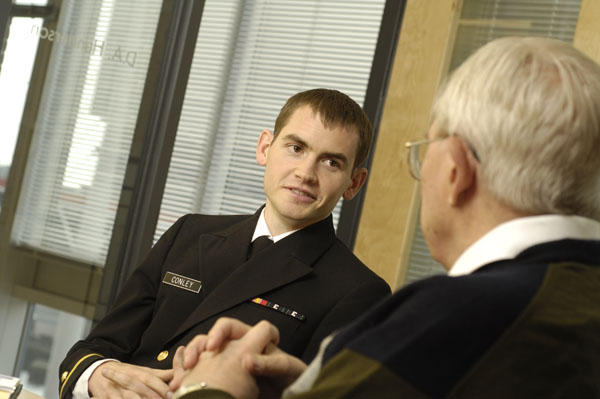 Kevin Conley, a naval officer, will be promoted to a U.S. Navy lieutenant during the 2009 College of Medicine graduation ceremony, on Saturday.