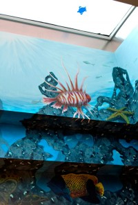 An aquatic mural paints the way to a skylight in the recovery room of the newly renovated Shands Children's Surgical Center.