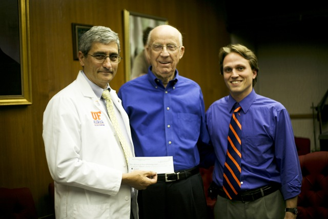 Left to right: Dr. William Driebe, chair of ophthalmology, Walt McLanahan, chair of the Lions Eye Foundation, Timothy Garrett, director of the General Clinical Research Center Core Laboratory.