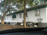 It's not unusual to find two or three migrant families living together in small trailers throughout Alachua County.