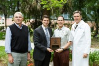 (from left) Joseph Fantone, M.D., senior associate dean for educational affairs, medical student Josh Cohen, class of 2013 president, Robert Hollander, M.D., an adjunct assistant professor in the department of medicine and the 2013 Hippocratic Award winner, and Michael L. Good, M.D., dean of the UF College of Medicine at the 2013 Hippocratic Award Ceremony at Wilmot Gardens.