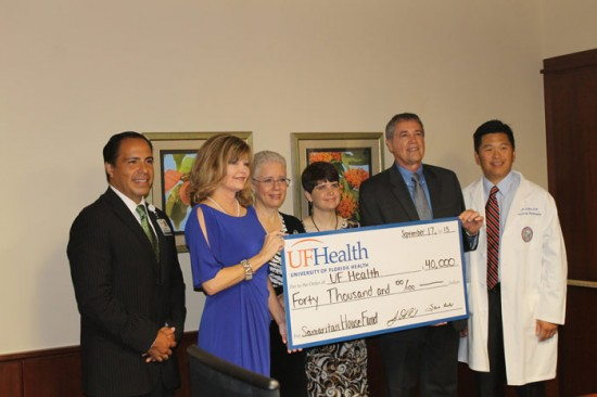 At the September check presentation are (from left to right) Ed Jimenez, senior vice president and COO of UF Health Shands; Sara Rich, co-founder of The Samaritan Hospitality House Inc.; Hedy Maus, board member; Leslie Rich, secretary; Donald Rich, co-founder; and Brian Hoh, M.D., chief of UF's neurovascular program and Leslie's neurosurgeon. Photo by Jesse S. Jones