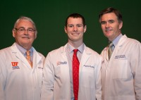 First-year medical student Peyton Keeling poses with Joseph Fantone, M.D., and Michael L. Good, M.D., after receiving his white coat. Photo by W. Charles Poulton