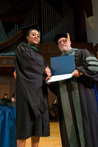 A student receives her degree from associate dean and director Ralph W. Rice, DHSc, PA-C. Photo by Jeff Knee
