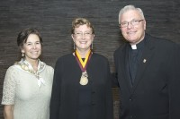 Hardt received the Damen Award from Loyola University Chicago, which awarded one such award to an alumnus or alumna from each of its 12 schools and colleges. Pictured with Hardt are Stritch School of Medicine dean Linda Brubaker, M.D., M.S. (left) and Loyola University Chicago president Rev. Michael J. Garanzini, S.J. Photo courtesy of Nancy S. Hardt
