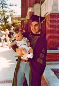 Frederick Monsour holds his 4-month-old son, Chris, after his UF College of Medicine graduation ceremony in 1979. Photo courtesy of Chris Monsour