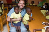 Tudeen with children at a school in Haiti. Photo courtesy of Michael Tudeen