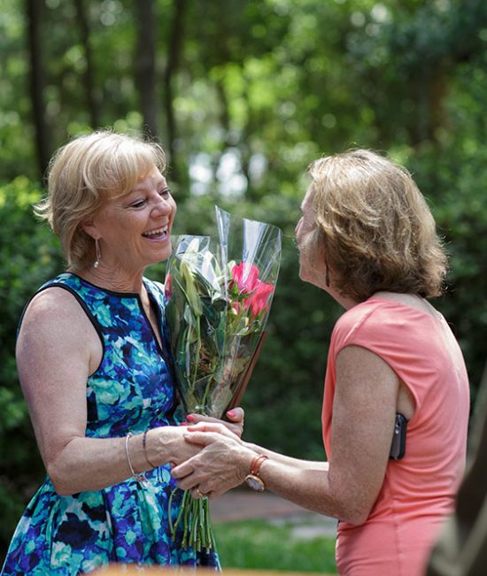 Maureen Novak, M.D., associate dean of medical education, greets Kathy Christensen at the Hippocratic Award Ceremony. Photo by Mindy C. Miller