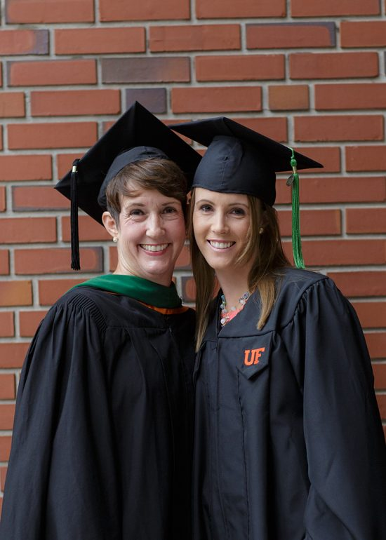 Susan Bonenclark, pictured left, graduated from the UF School of PA Studies in 2005. Her daughter, Loren, graduated on June 18 with the class of 2016. Photo by Mindy C. Miller