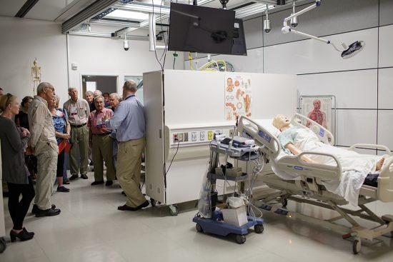 UF College of Medicine graduates tour the Harrell Medical Education Building.